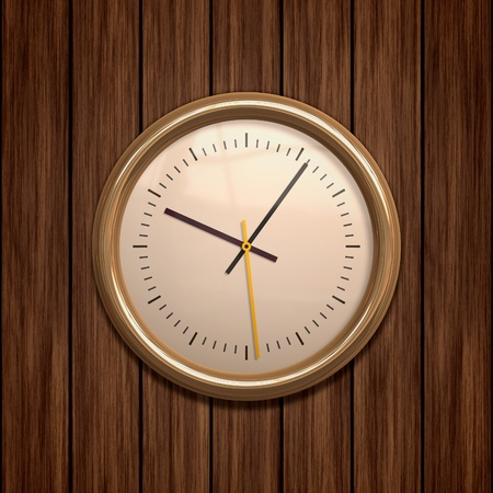 An image of a golden clock on wooden background photo