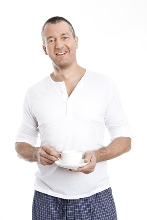 Un hombre guapo, con una taza de caf� Foto de archivo - 11740520