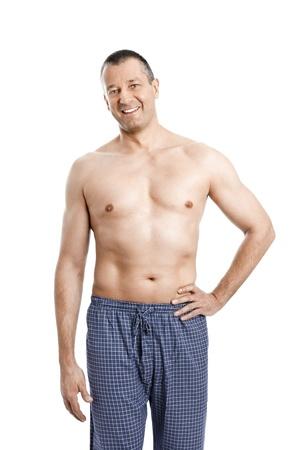 hombre sin camisa: Una imagen de un hombre guapo en pijama sin camisa Foto de archivo