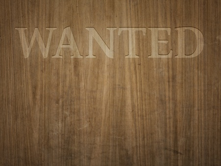 A beautiful wooden background with the word wanted photo