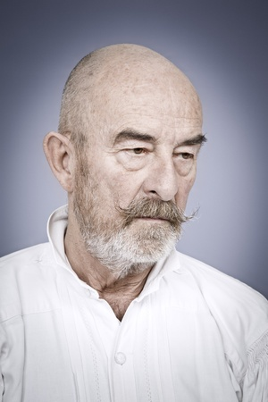 senior depression: An old man with a grey beard is hopeless Stock Photo