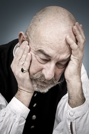 man crying: An old man with a grey beard is hopeless Stock Photo