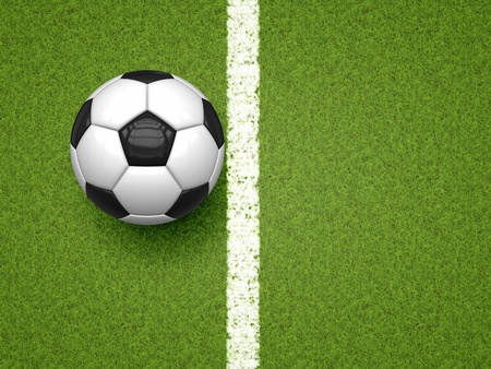 An image of a soccer ball on green grass background photo