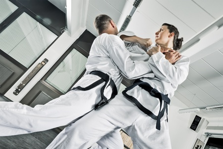 karate female: An image of two martial arts fighters Stock Photo