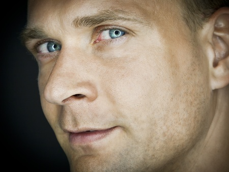 blue eyes: A portrait image of an attractive male with blue eyes