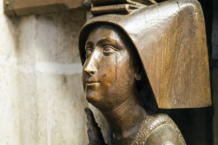 curch: An image of an old female face in the curch of Ulm Germany Editorial