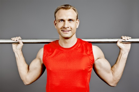 An image of a fit man in a red shirt photo