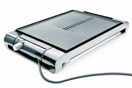 An image of a new electric barbeque on white background photo