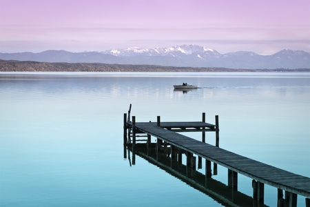 crescent lake: An image of a wooden jetty at the lake Starnberg in Bavaria Germany