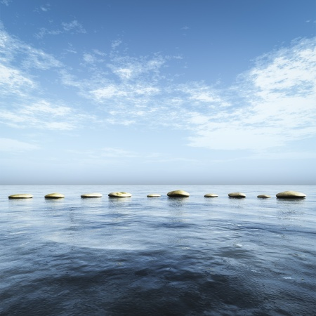 An image of step stones in the blue sea photo