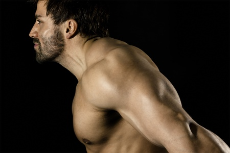 triceps: An image of a handsome young muscular sports man Stock Photo