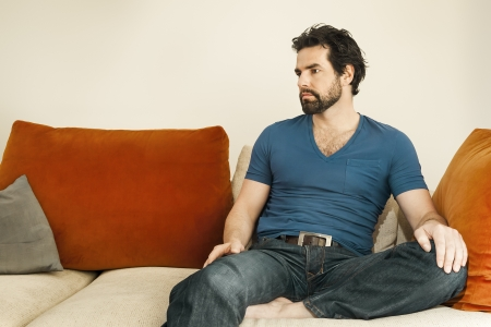 An image of a handsome but depressed man with a beard Stock Photo - 13900148