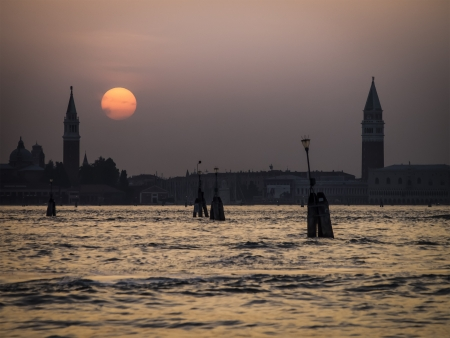 An image of a sunset in Venice Italy photo