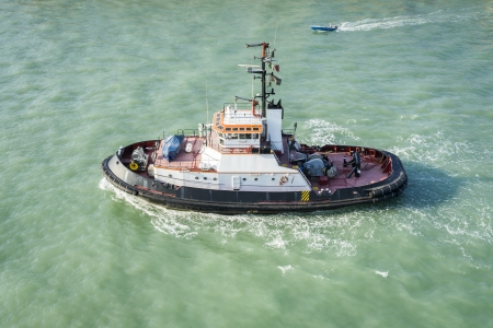 An image of a tug boat in Venice Italy photo