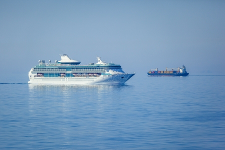 An image of two ships in the blue sea photo
