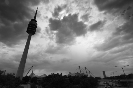 the famous olympia tower in munich under a dramatic sky