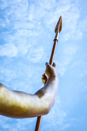 spears: An image of a golden spear in front of a blue sky