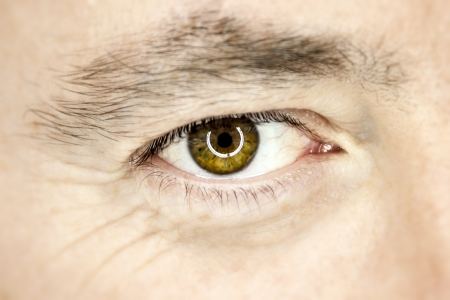 An image of a brown male eye