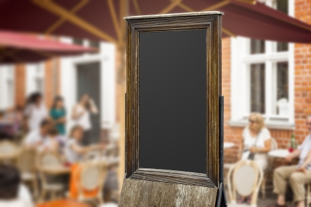 An image of an old blackboard in a pedestrian area photo
