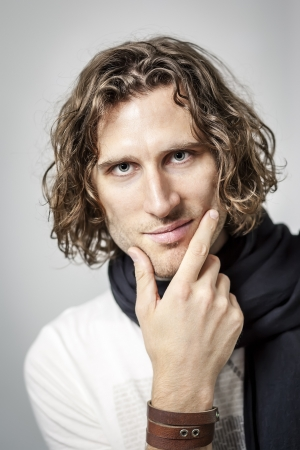 An image of a handsome man with a curly hairdo photo