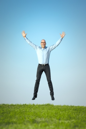 An image of a happy jumping man photo