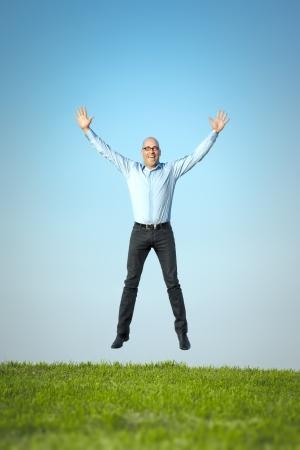 air jump: An image of a happy jumping man Stock Photo