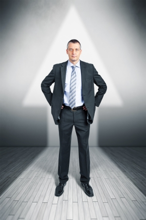 An image of a manager in a arrow shape light upwards photo