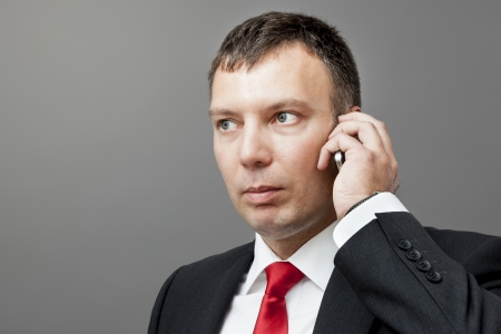 An image of a businessman on a mobile phone photo