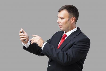 An image of a handsome business man and his mobile phone photo