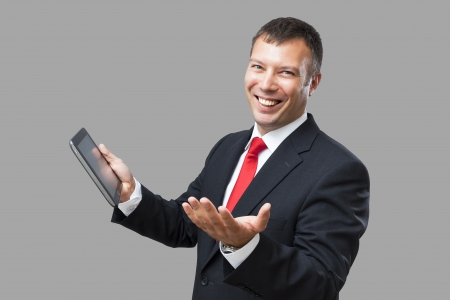 An image of a handsome business man and his tablet pc photo