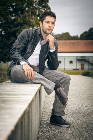 An image of a handsome man outdoor photo