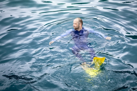 diving save: An image of a man swimming in his safetysuit