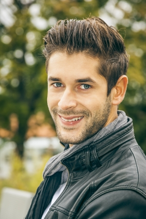 males only: An image of a young man with a black leather jacket