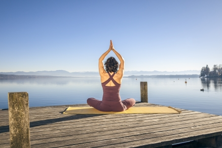 An image of a pretty woman doing yoga at the lake Stock Photo - 16374712