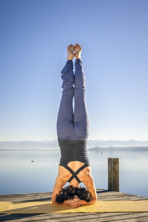 yoga meditation: An image of a pretty woman doing yoga at the lake