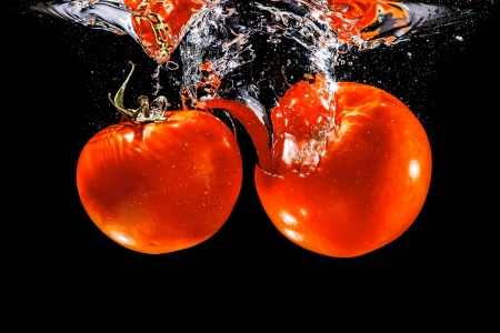 An image of two tomato in the water photo