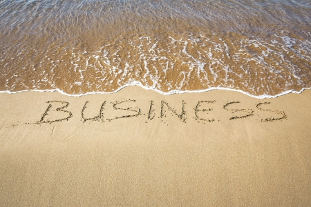 An image of a word in the sand: BUSINESS photo