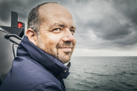 work boat: An image of a man at the bad sea Stock Photo