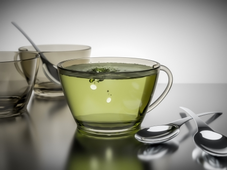 sweetener: An image of a cup of green tea with artificial sweetener