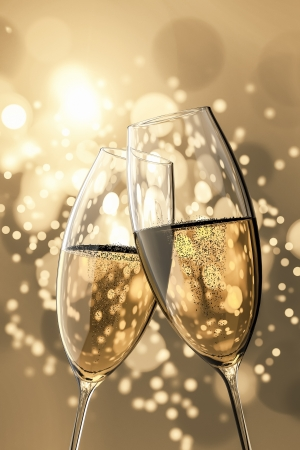 champagne glasses: An image of two Champagne glasses on light bokeh background Stock Photo