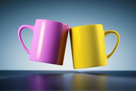 An image of two weightless coffee mugs Stock Photo