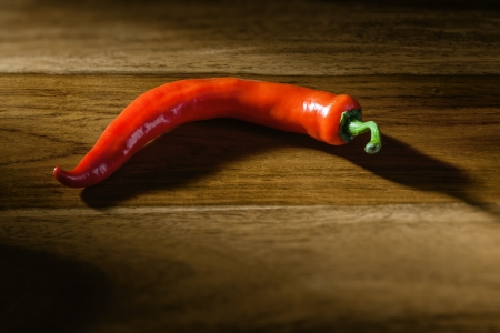 freigestellt: An image of a red peperoni on a wooden background Stock Photo