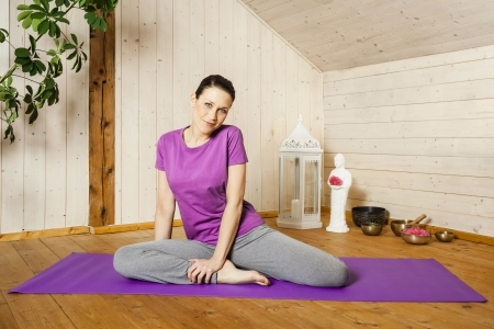 room mate: An image of a pretty woman doing yoga at home