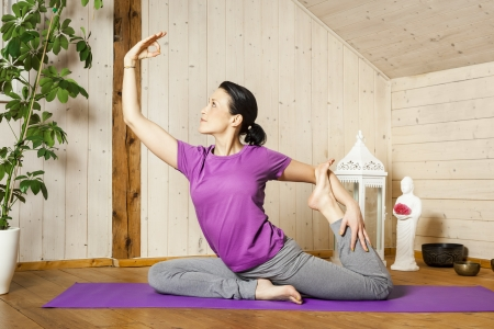 An image of a pretty woman doing yoga at home Stock Photo - 18057713