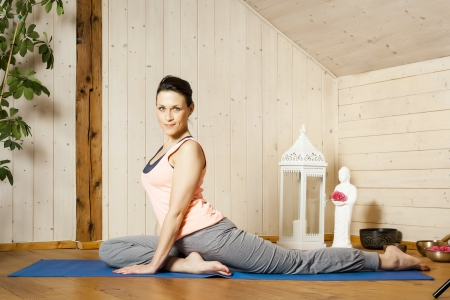 An image of a pretty woman doing yoga at home Stock Photo - 18057720