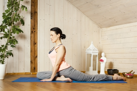 An image of a pretty woman doing yoga at home Stock Photo - 18057703
