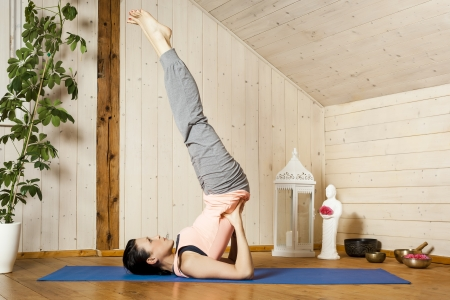 An image of a pretty woman doing yoga at home - Salamba Sarvangasana Stock Photo - 18057701