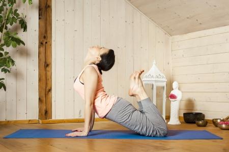 An image of a pretty woman doing yoga at home - Urdhva Mukha Shvanasana Stock Photo - 18057717