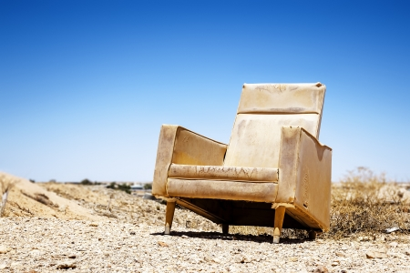 An image of an old chair outdoor photo