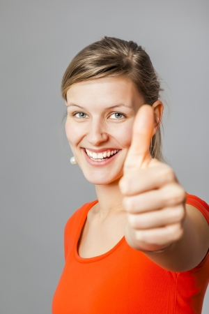 An image of a young woman with a thumb up photo